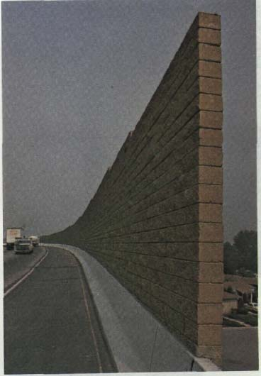 Photo Of A Highway With Tall Brick Wall