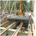 Photo Of Placement of Fiber Reinforced Polymer (FRP) Deck Panels On Steel Girders.