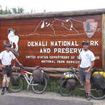 Bicyclists at the Denali National Park Welcome Sign