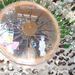 Bottle Necks Around a Spoke Wheel Window at Tinkertown