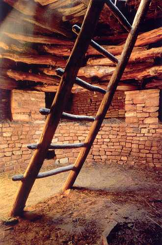 Visitors may climb the ladder into the reconstructed kiva and wander through the residence block around the kiva at the Three Kiva Pueblo.