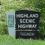 An entrance sign greets visitors to the Highland Scenic Highway