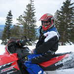 A Confident Snowmobile Guide