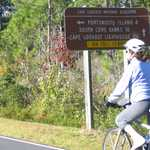 Biking past Directional Sign in Cape Lookout National Seashore