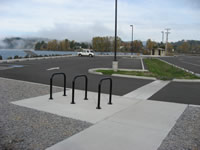 Parking area with lake views and restroom in background. Public restrooms, picnic facilities, walkways and parking facilities to accommodate cars, recreational vehicles, busses, and bicycles were constructed.