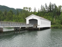 View of Lowell Covered Bridge. Constructed in 1945, the Lowell Covered Bridge is listed in the National Register of Historic Places.
