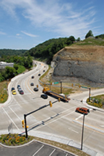 Aerial photo of the signalized intersection.  State Route 8 curves around the rock cut slope to approach the intersection.