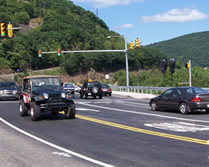 Photo of traffic flowing at the new signalized intersection of SR 61 and the Connector road just north of the bridge.