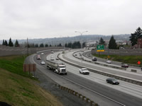 Photo of the I-5 freeway with noise walls on both sides.