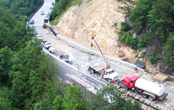 Photo showing construction of one of the bridge abutments on the steep slope.
