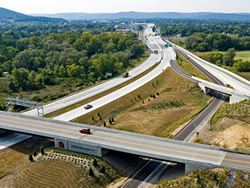 Photo of State Route 17 (future Interstate 86) with multi-level interchanges.