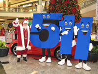 Mascots representing the  5-1-1 travel information number, with Santa Claus, on location at Gwinnett Place Mall.