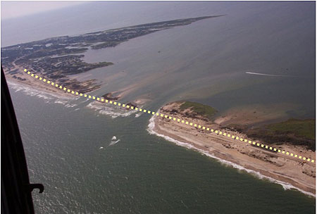 Figure 2.6. Breaches in Outer Bank barrier island caused by Hurricane Isabel in 2002 (NC 12 ROW is dotted line).
