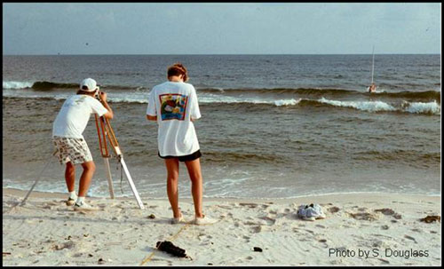 Figure 5.10. Beach profile surveying crew using a traditional level-rod and tag line system