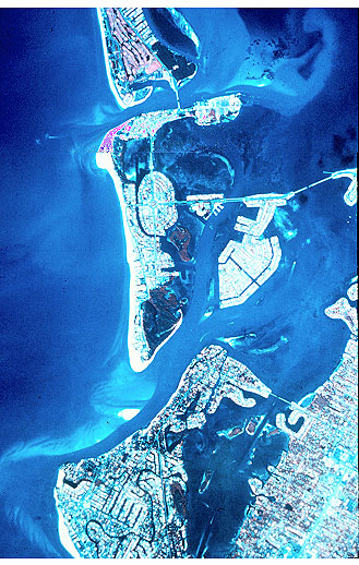 Figure 5.19. Two tidal inlets on the southwest Florida coast (New Pass and Big Sarasota Pass). Lido Key is the barrier island between the two inlets. Net longshore sand transport is to the south.