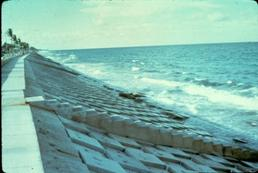 Figure 6.18. Example of rigid concrete-block revetment failure (Florida Highway A1A, Delray Beach, circa 1972; University of Florida and USACE archive photos)