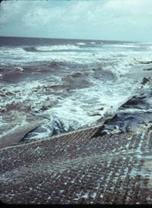 Figure 6.19. Example of failed block revetment (Louisiana Highway 87, circa 1980, USACE archives photos)