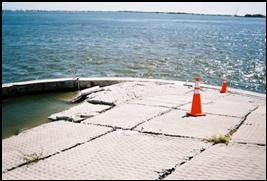 Figure 6.20. Example of rigid revetment failure on a coastal highway bridge approach