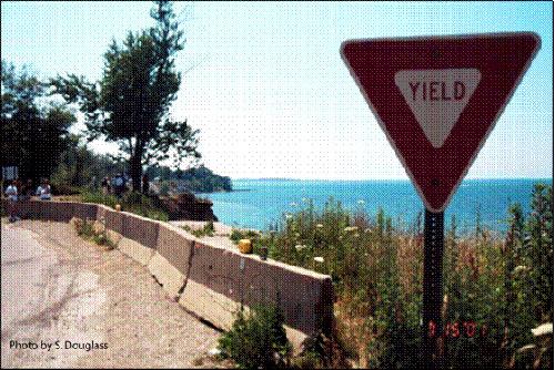 Figure 7.4. A local road being undermined by bluff erosion and long-term shoreline recession on the Great Lakes. Painesville, Ohio, 2001