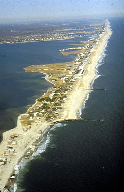 Figure 7.14. Severe shoreline recession and beach erosion downdrift of a groin field (West Hampton, New York, circa 1985, New York Sea Grant photo)