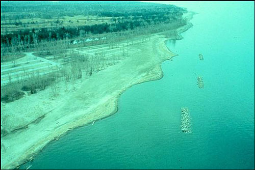 Figure 7.19. Offshore segmented breakwaters with salients in beach nourishment (USACE archive photo, circa 1980).