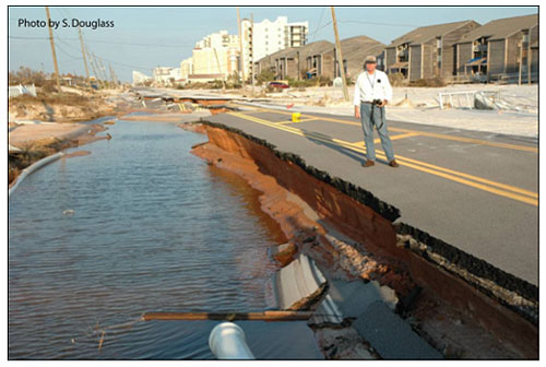 Figure 8.2. Example of pavement damage due to storm surge. (Florida 292 on Perdido Key, Florida after Hurricane Ivan; Sept. 2004)