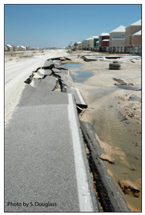 Figure 8.15. Evidence of weir-flow damage to the seaward edge of pavement due to return flow late in the storm (West Beach Blvd., Alabama 182, Hurricane Ivan, Gulf Shores, Alabama).