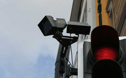 Photo of a Pedestrian Sensor next to a Signal Light.