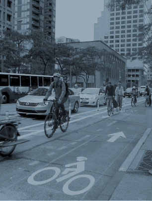 Cover photo: People riding bikes in a bike lane in urban setting.