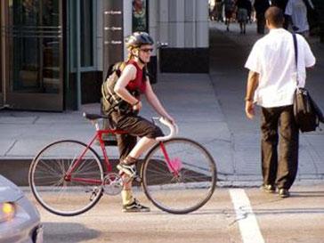 Lady riding a bike.