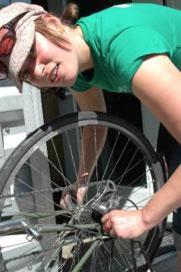 Lady fix bike crank.