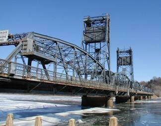 Photo of a bridge crossing an icey river.