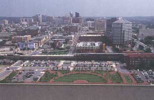 Aerial photo of urban area with riverfront greenspace