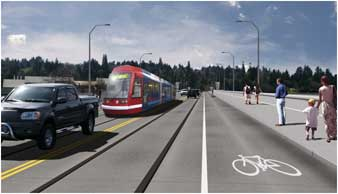 Photo of new bridge concept with vehicles, commuter train, wide sidewalsk, and bike lanes.