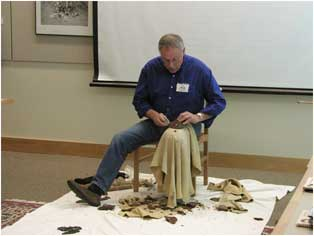 Photo of a man demonstrating flint knapping