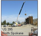 Photo of a crane and bridge under construction US 395 North Spokane