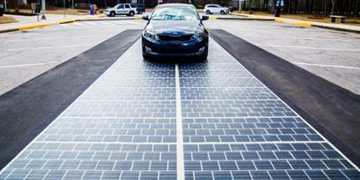 A car drives on a solar roadway.