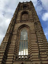 Sint-Petruskerk church tower rises steeply into the sky.