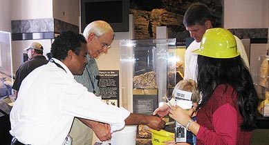 On September 29, Richard Meininger (rear), a civil engineer and member of FHWA's pavement materials research team, and Mengesha Beyene (front), a geologist and contractor at TFHRC, volunteered their time at an educational event on rocks and geology at the National Museum of Natural History.