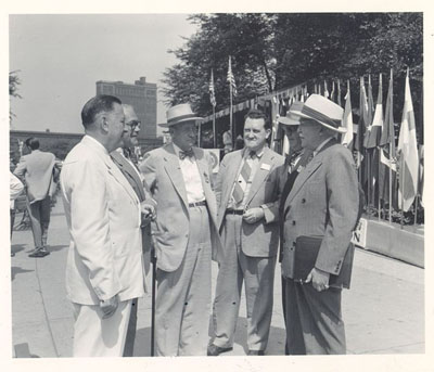 General Philip B. Fleming, Administrator of the Federal Works Agency, home of the Public Roads Administration, with Director Charles Upham and group at the 1948 convention of the American Road Builders Association in Chicago.