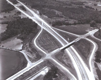 Alabama - Separate roadways fitted into the landscape, as seen beyond the diamond interchange, are typical of design on Interstate Route 59 between Argo and St. Clair Springs.  (Not yet in use when photographed.)