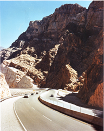 Arizona -The rugged beauty of the Virgin River Gorge is brought to light as this portion of Interstate 15 deftly winds its way through this colorful canyon completed 1973