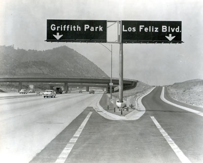 California - Ground view of the Las Feliz Boulevard interchange showing the signing, striping, and the single circular, column bents on the Las Feliz Boulevard on-ramp structure.  Signs on Golden State Freeway - Aug. 15, 1958.