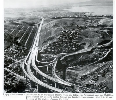 California - Interstate 80 at Carquinez Straits with new bridge in foreground and the 8 million yard benched cut at left center beyond the Crockett interchange.  Old U.S. 40 can be seen at the right.  January 29, 1959.