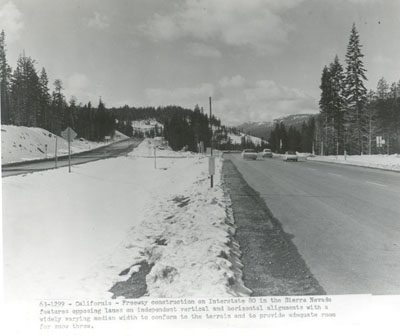 California - Freeway construction on Interstate 80 in the Sierra Nevada features opposing lanes on independent vertical and horizontal alignments with a widely varying median width to conform to the terrain and to provide adequate room for snow throw.