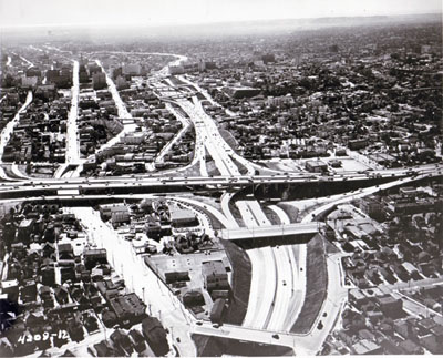 Looking southerly along Harbor Freeway showing Alpine Street overcrossing.  Four -level traffic interchange structure in center. ( California Department of Public Works photo)