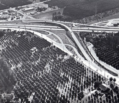 Santa Ana Freeway, looking northeasterly toward Los Angeles Street interchange (three-quad modified diamond interchange) California Department of Public Works photo.