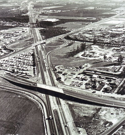 Santa Ana Freeway, with Ball Road overcrossing in foreground. Disneyland is on the right. (California Department  of Public Works photo)