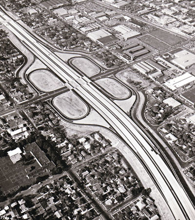 Looking northwest along the Golden State Freeway showing western Avenue cloverleaf in Glendale (four-quad cloverleaf interchange with collector-distributor roads.) California Department of Public Works photo