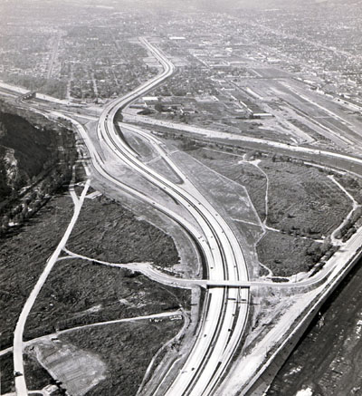Golden State Freeway looking northwest across northeast corner of Griffith Park. Three-leg connection to Victory Street in upper left, future connection from south east Colorado Freeway to  right (stubs shown). California Department of Public Works photo